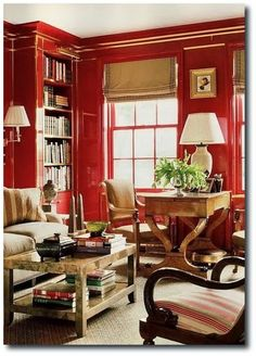 [What a beautiful room! I love the red lacquer, the chair with the curving arms, the desk, and the welcoming atmosphere. The red and tan color scheme is very appealing.]