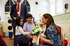 February 18, 2015 - The Duchess receiving a bouquet of flowers from the Cape Hill children