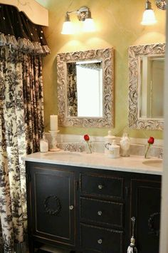 Picture frame mirrors - love the elegance of this bathroom.
