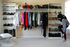 Do two rods and use inexpensive bookshelves to store your shoes and purses on either side.