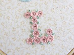 This is such a cute little letter.      And I love making flowers with this ...      a pinwheel bl...