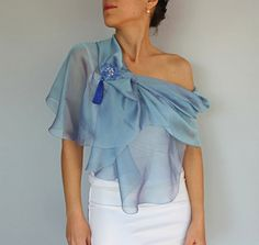This modern scarf / shoulder stole is made with sky blue silk chiffon fabric, iridescent with lilac tones. Its rectangular in shape but corners are rounded to give a smooth look. A silver plated brass stick pin brooch is included as a complementary accessory to fix the scarf when used as bolero shrug. Its made with hand tatting lace in blue shades, decorated with silk tassel and rectangular rhinestone accent on the center, Its long enough to allow to usages as seen at the pictures above....