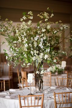 I like the idea of a really tall centerpiece or a really low one...nothing is more annoying than a bunch of flowers blocking you from the people across the table! This arrangement is beautiful.