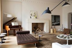 The coolest apartments are always in Paris. This one is by Monaco interior architect team Humbert & Poyet. A stunningly simple fireplace, graphic artwork, classic furnishings by the likes of Eero Saar