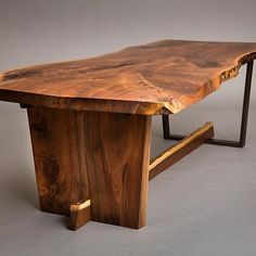 Black walnut live edge table. Half wood half steel base. @cparkphoto