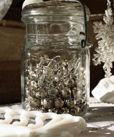 This a simple and inexpensive holiday decor idea...a vintage Ball jar filled with jingle bells.