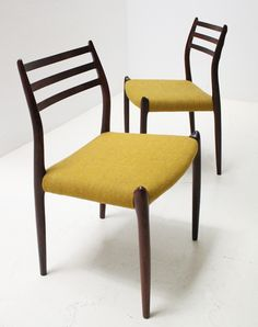 A pair of dining chairs model 78 designed by Niels O. Møller in 1962 for J.L. Møllers Møbelfabrik, Denmark. Solid rosewood frame and original wool fabric.