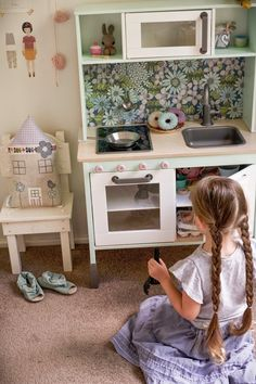 This Duktig update from Little Village has some useful how-to, including for painting, varnishing, applying oven knobs and the splashback.