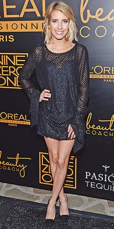 EMMA ROBERTS Also at the Nine Zero One party in L.A. is Emma, flaunting lots of leg in a long-sleeve black minidress and matching pumps.
