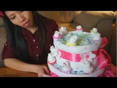 Just a quick video on how to make a simple but elegant Diaper Cake for a baby girl. Diaper cakes are fun gifts to bring to Baby Showers or just to give to friends or family members who are expecting a baby. Thank you so much for watching!  Thom : )    Diaper Cake - Baby Shower - Party Favor - Gift - How To Make - New Born