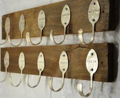 Spoons hammered into a piece of salvaged wood = pretty original coat hooks