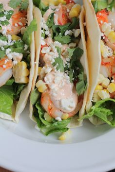 Grilled Shrimp Tacos with grilled corn and a Spicy Mexican Crema sauce. Fresh, insanely flavorful and so easy to make!