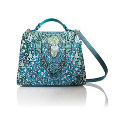 Coming soonLight as a Feather,Top handle, Featherlight handbag  This print is an explosion of printed feathers. Vivid greens, turquoise blue and pastels are this bags statement colours. This is the perfect print to make a statement.  INFORMATIONOur Maxi bag this season. There is a magnetic closure, detachable shoulder strap and padded handle. Inside there is plenty of space for you to throw your bits and bobs. However if your one of those organised people, we have ...