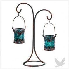 Fascination begins as candlelight glows behind turquoise glass and intricate copper scrollwork. Dramatic double votive stand adds an air of mystique that's ever so right for a special night! Iron and glass. Candles not included. Light Of Life, Love And Light, Mood Light, Lamp Light, Backyard Movie Nights, Wedding Supplies Wholesale, Flame Design, Turquoise Glass, Colored Glass