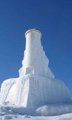 Frozen Petoskey Lighthouse, winter 2007.  Built in 1884 on the peninsula of Harbor Point in little Traverse Bay, northern Michigan.
