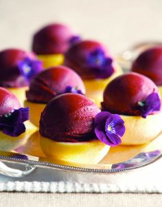 Blackberry Cabernet Sorbet - served on a Lemon halve w/ a pansy garnish. Pretty & delicious <3