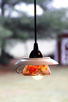 Drill holes through a pretty saucer and teacup, connect your lighting fixture, and voila ... a pretty DIY chandelier!