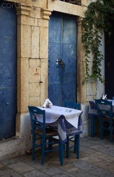 Small table in outdoor restaurant, Symi, Greece