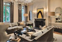 Very inviting of conversation and I like the black fireplace with zebra pattern bench and chandelier. I don't like the rough rug or wingback chair.