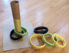 Make your own ring toss from tp or paper towel rolls ... making it is part of the way to get busy ... safe indoor activity ... for ages 2 or above
