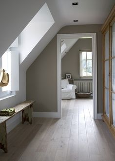 gorgeous tones of Greige and white - simple contemporary country living- BONUS SPACE WINDOW IN ROOF SLOPE. LOVE. The wood floor and the wall color together