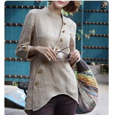 @zenb.com What shape and style in fresh neutral linen. Asian style asymmetrical buttoned jacket or top.  #sophisticated#elegant#tunics#linenjacket#linentop#asymmetrical#transseasonal#classy#chic#chicatanyage#styleatanyage#atanyage#casualstyle#casualwear#everydaywear#everydaylookers#style#ageless#streetstyle#ootd