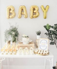 Need baby shower inspiration? This gorgeous Oh Baby theme set up is perfect! We love pairing metallic golds with greenery for the most effective baby shower set up! Décoration Baby Shower, Gateau Baby Shower, Bebe Shower, Fiesta Baby Shower, Gold Baby Showers, Gender Neutral Baby Shower, Shower Party, Baby Shower Parties, Baby Shower Gifts