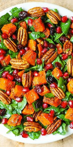 Butternut Squash Spinach Salad with Pecans, Cranberries, Pomegranate with Poppy Seed Honey-Lime Dressing. Thanksgiving, holiday gluten free, healthy salad.
