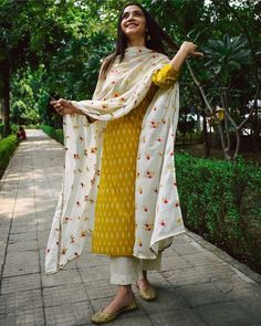 Shop online Dandelion Ikat Printed Suit Set - Set of Three Dandelion yellow ikat printed cotton kurta, teamed with a beautifully embroidered mul dupatta and embroidered cotton pants makes for a flawless ethnic outfit. Simple Kurti Designs, Kurta Designs Women, Blouse Designs, Pakistani Dresses Casual, Pakistani Dress Design, Indian Wedding Outfits, Indian Outfits, Wedding Outfits For Women, Casual Indian Fashion