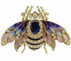 ART NOUVEAU BROOCH: yellow gold, 39 diamonds 0,62 ct., 1 sapphire 1,94 ct. and enamels.