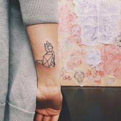 geometric cat tattoo seen on masha sedgwick