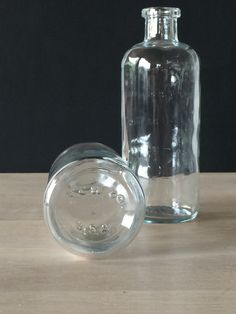 """We love these new """"old stock """" bottles as small flower vases. Originally made as baby bottles, they are the precursor to plastic formula bottles. The glass is nicely weighted at the base. Marked """"T.C."""