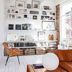 Utilising small spaces with shelves and boxes.  Vinyl storage, littered with pictures and knick knacks?