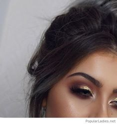 Gold and brown eye makeup and messy hair