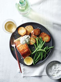 Salmon with Potatoes and Horseradish Sauce | You can't go wrong when you start with salmon and a sour cream sauce, especially if the sauce is flavored with dill and horseradish. Fill out the plate with a side of steamed green beans.
