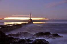 The south breakwater, Aberdeen, Scotland  Long exposure shot with the Northlink ferry sailing to Shetland in the background.