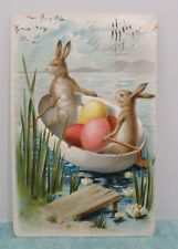 1906 EASTER POSTCARD TWO HUMANIZED RABBITS ROWING AN EGG BOAT