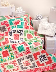 Pair an unusual combination of persimmon red and jade green in this pretty Garden Lattice Christmas quilt by Cindy Lammon, from the book Simply Modern Christmas.