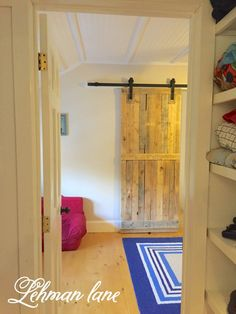 We made a barn door out of 2 Pallets. Since our youngest's room was originally a master closet it was long and narrow.  With his bedroom door…