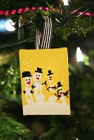 hand print snowman ornaments.  Or make it into a Christmas card.