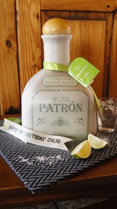 Fondant Covered Patron Silver Tequila Bottle Shaped Cake. Complete with real shot glass...to be served with a shot as well!