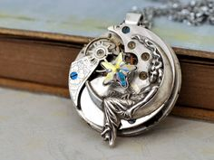steampunk necklace - Love You To The Moon And Back -  lunar goddess charm with star shaped  Swarovski jewel. $69.50, via Etsy.