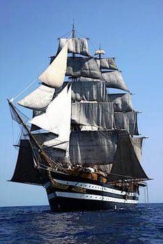 Full masted sailing ship