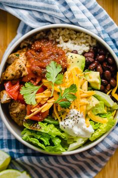 Southwest Chicken Burrito Bowls are a healthy and filling dinner idea for everyone! Delicious marinated grilled chicken is served over brown rice and with your favorite southwest toppings. Chicken Burrito Bowls can easily be meal prepped for the week or turned into an easy freezer meal. #burritobowl #mealprep Chicken Freezer Meals, Healthy Freezer Meals, Chicken Recipes, Easy Chicken Burrito Bowl Recipe, Marinated Grilled Chicken, Southwest Chicken, Chicken Burritos, Meal Prep For The Week, Yum Yum Chicken