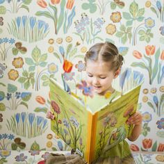 girl reads book with flowers