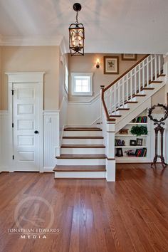 Love the built-ins under the stair case