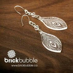 Brickbubble | #laser #engraved peacock feather #earrings. << Now this is laser-cut jewelry I'd wear.