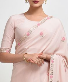 From our Wedding Collection, this is a Nude Pink pure crepe saree and blouse with intricate exquisite rose gold gota patti and floral hand embroidery, embellished with pearl bead highlights. The saree has embroidered borders inches wide and Crepe Saree, Tussar Silk Saree, Chiffon Saree, Indian Dresses, Indian Outfits, Pakistani Dresses, Sari Dress, Sari Blouse, Designer Dress For Men