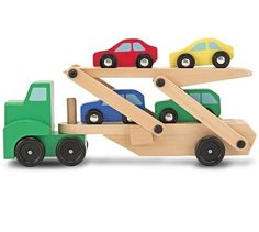 Melissa & Doug Childrens Toys Car Transporter This cool, wooden car carrier from Melissa and Doug comes with four colourful cars and an easy-load ramp which Wooden Car, Wooden Train, Wooden Playset, Mini Car, Car Carrier, Interactive Toys, Car Set, Toy Trucks, Wood Toys