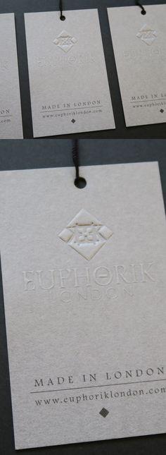 Euphorik menswear embossed swing tag on GF Smith Colorplan grey #embossed #swingtag #theusualstudio